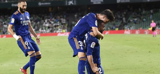 Real Madrid's Dani Carvajal, right, celebrates with teammates after scoring his side's opening goal during the Spanish La Liga soccer match between Real Betis and Real Madrid at Benito Villamarin stadium in Seville, Spain, Saturday, Aug. 28, 2021. (AP Photo/Jose Breton)