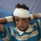 FILE - In this Aug. 12, 2018 file, photo, a child who was injured in a deadly Saudi-led coalition airstrike rests in a hospital in Saada, Yemen. The United Nations said Tuesday, Oct. 19, 2021 that more than 10,000 children in Yemen have now been killed or injured in violence linked to years of war in the impoverished country. The children's agency UNICEF said the verified tally is surely an undercount of the real toll. (AP Photo/Hani Mohammed, File)