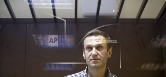 FILE - In this Feb. 20, 2021, file photo, Russian opposition leader Alexei Navalny stands in a cage in the Babuskinsky District Court in Moscow, Russia. Russia is holding three days of voting and there's no expectation that United Russia, the party devoted to President Vladimir Putin, will lose its dominance in the State Duma. The main question is whether the party will retain its two-thirds majority that allows it to amend the constitution. Another question is whether the Smart Voting strategy devised by Navalny will prove viable against United Russia. (AP Photo/Alexander Zemlianichenko, File)